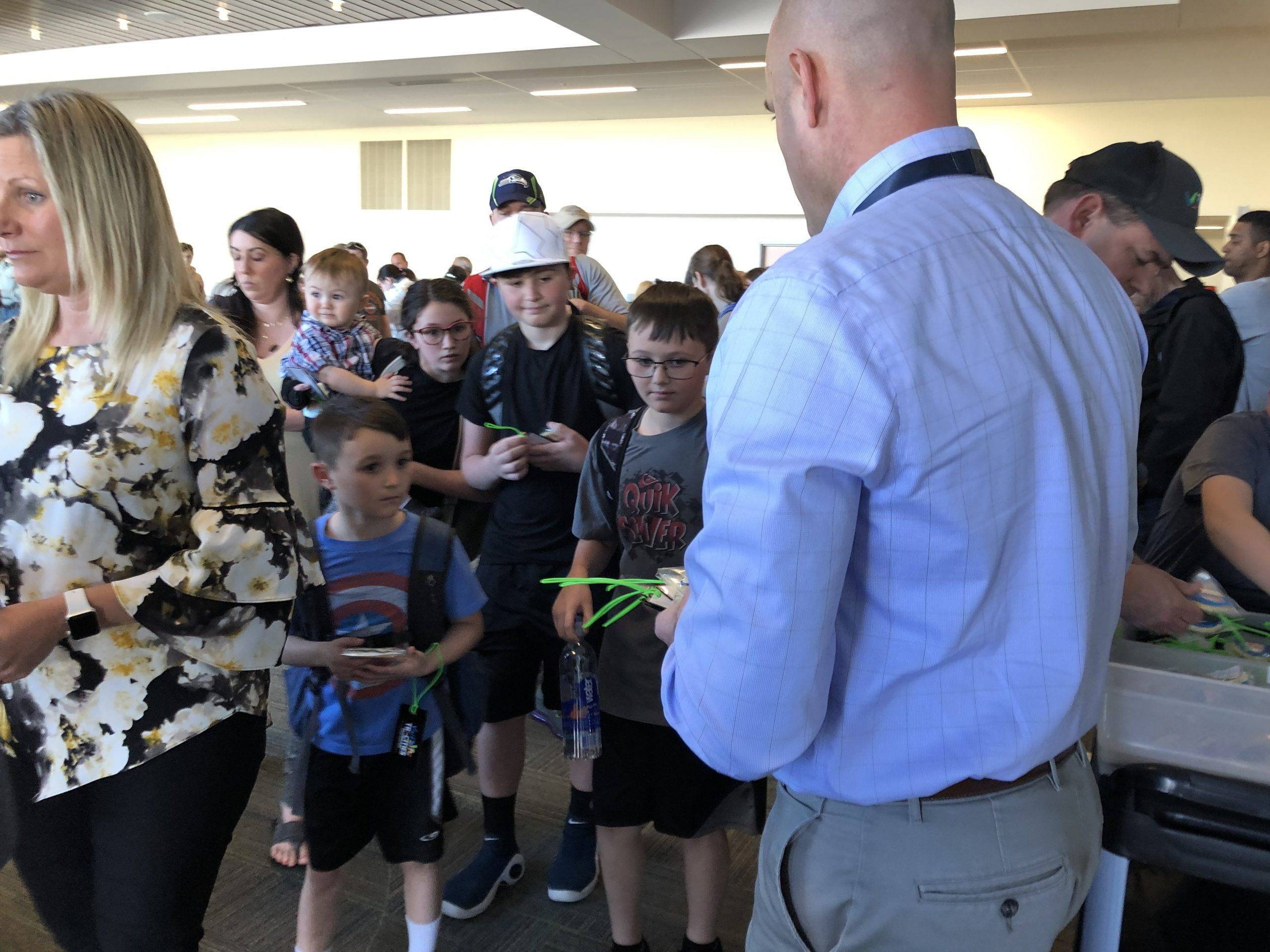 airport director hands out gifts